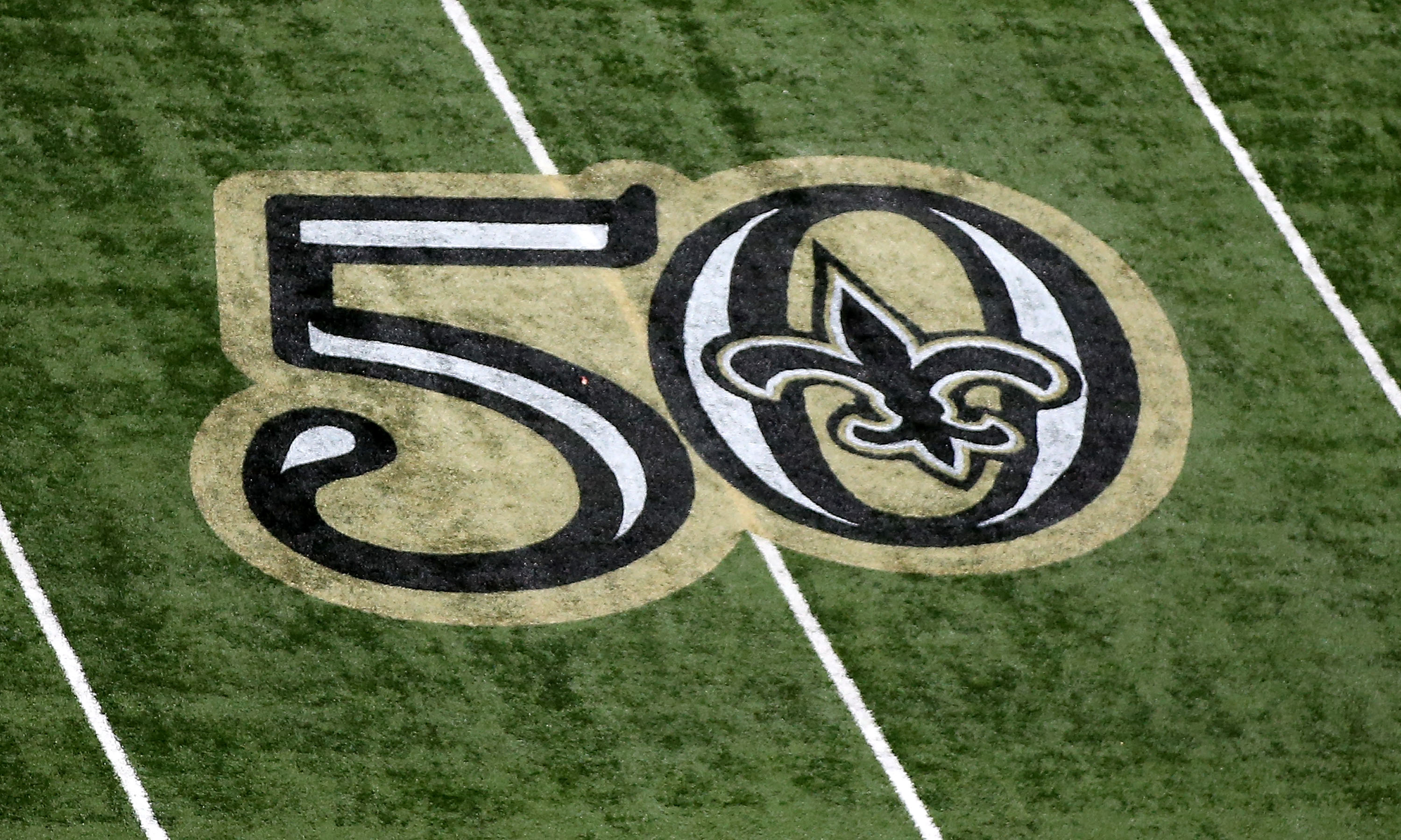 New orleans saints divisional outlook nfc south mock draft page 5 new orleans la october 16 a logo celebrating the new orleans saints organization for fifty years is painted on the field at the mercedes benz superdome biocorpaavc Gallery